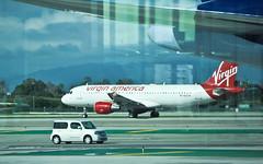 Airplanes at LAX (Nazra Zahri) Tags: california usa holiday losangeles nikon airplanes lax nikkor runway taxiing 28200mm losangelesinternationalairport 28200mmf3556g 2013 tombradleyinternationalterminal d700