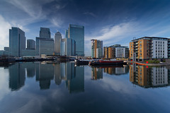 Cool Reflections (www.paulshearsphotography.com) Tags: city uk greatbritain blue homes winter england urban cloud money london art water clouds marina buildings reflections boats photography photo cool artist cityscape bright unitedkingdom britain picture houseboat sunny business flats docklands metropolis canarywharf residential statestreet hsbc citigroup banks houseboats offices e14 finance citi cliffordchance barclaysbank blackwallbasin blackwellbasin paulshears paulshearsphotography