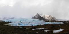 the saddening meltdown (lunaryuna) Tags: iceland southeasticeland fjallsjokull glacier glacierlagoon mountainrange landscape panorama winter season seasonalwonders glacialicefloes thecolourofcold lunaryuna