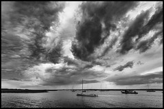 Approaching Storm (Aimless Alliterations) Tags: england sigma1020mm uk nikond7000 norfolk bw silverfxpro coast brancasterstaithe boats moorings estuary creek sky wide