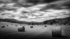 Hays Bales With Clouds In Motion (shutterclick3x) Tags: meadow hay haystacks countryside bw backroads blackandwhite le longexposure frankloose