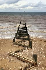 Old timber groyne (nicholas_riches) Tags: waves foam timber vignette northsea thewash pebbles sand grey blue snapseed camera sea beach