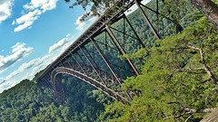 Southern Connection (trainmann1) Tags: samsung galaxy note4 cellphone phone amateur handheld westvirginia newrivergorgebridge newrivergorge fayetteville wv bridge trees steel rust road interstate clouds green blue white brown architecture massive large tall