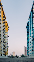 Inbetween (drumbunkerdragon) Tags: rochor centre hdb flat building beautiful yellow blue colour wheel opposing colours colors inbetween sky evening people singapore central city skyline apartment old history symmetry