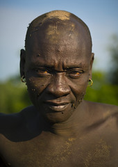 Bodi Tribe Man, Hana Mursi, Omo Valley, Ethiopia (Eric Lafforgue) Tags: africa portrait people man color vertical outside photography colorful day serious outdoor earring culture lifestyle tribal plantation omovalley relocation strength tradition ethiopia tribe pastoral ethnic threat oneperson onepeople confidence hornofafrica ethnology bodi omo eastafrica oneman onepersononly realpeople colorimage agrobusiness lookingatcamera meen onemanonly waistup africanethnicity pastoralist pastoralism img2550 snnpr landgrabbing settlementarea oneadult oneadultonly southernnationsnationalitiesandpeoplesregion ethiopianethnicity hanamursi livelihoodpreservation