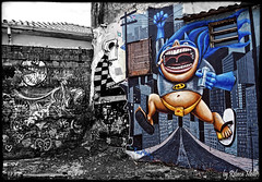 Alley of Batman (Rebeca Mello) Tags: street city cidade brazil urban streetart art wall brasil photoshop canon drawing sopaulo ps pop popart urbano rua popular graphite desenho parede grafite selectivecolor cs5 canoneos50d rebecamello rebecamcmello