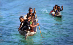 Bajau Kids (nelza jamal) Tags: life blue boy sea food playing green girl smile smiling kids race children island photography boat photo child play bokeh row daily safari malaysia float sabah happyfaces bajau sempoerna bajaukids nelzajamal