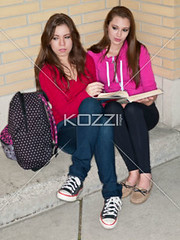 two friends looking away while studying (elisapeople2012) Tags: friends girl beautiful beauty modern female bag reading book togetherness student education pretty sitting friendship fulllength teenagers learning companion studying twopeople casualwear bonding lookingaway caucasian schoolbag companionship youthculture casualclothing universitystudent 1617years teenagersonly legscrossedatknee onlygirls personineducation secondaryschoolchild teenagegirlsonly personinfurthereducation