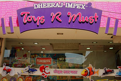 Toys R Must (cowyeow) Tags: santa pink india art strange sign retail kids toy toys design weird crazy funny purple market indian humor gifts badsign santaclaus stolen wtf must mumbai copy ripoff toysrus funnysign copyrightinfringement toystore copied funskool indianretail funnyindia