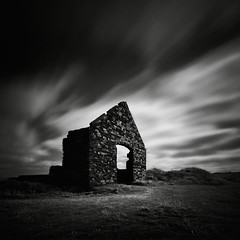 Portal (Andy Brown (mrbuk1)) Tags: door longexposure sky cloud building brick grass wales contrast dark square landscape mono blackwhite mood arch dynamic path grain ruin dramatic walls drama derelict pembrokeshire gable porthgain neutraldensity leefilters bwfilters