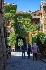 Civita Center (Bob Radlinski) Tags: travel flowers people italy vines europe ivy umbria civita medievalvillage hilltopvillage imgp6471