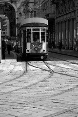Trams in Milan (ONETERRY. AKA TERRY KEARNEY) Tags: autumn trees winter sky people urban italy sun milan art heritage history nature water sunshine gardens skyline architecture canon buildings reflections river landscape geotagged island italian october europe flickr wildlife transport culture parks cathedrals unesco explore monuments lakecomo kearney 2012 ballagio milancathedral oneterry terrykearney geo:lat=45465454 geo:lon=9186516
