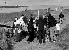 Winter walk (farwest56) Tags: uk travel england people blackandwhite bw holiday man beach walking 50mm mono sand women cornwall sony shoreline tourists seashore gwithian stivesbay a350 sal50f14
