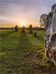 Sunrise Shadows (Chris Beard - Images) Tags: uk blue winter orange colour green monument colors grass yellow sunrise landscape dawn ancient colorful colours stones january worldheritagesite colourful wiltshire nationaltrust prehistoric neolithic stonecircle henge prehistory oldstones pagans historicmonument 2600bc newstoneage ibeauty aveburydawnsunrisestones
