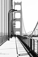 Walkway [Explore] (melfoody) Tags: sanfrancisco bridge urban bw monochrome canon blackwhite explore goldengatebridge pedestrians suspensionbridge superbowlsunday explored 5dmkiii