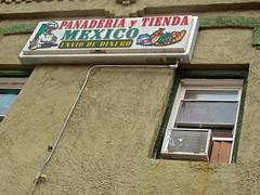Panaderia y Tienda, Perry, IA (Robby Virus) Tags: window sign mexico iowa mexican tienda bakery signage latino hispanic perry dinero panaderia envio