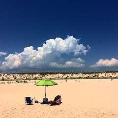 Beach umbrella clouds (rogermsherman) Tags: ocean beach clouds bluesky whitesand funinthesun cumulous beachumbrella