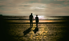 Love under golden sunset (miroslav.tokarsky) Tags: pentax pentaxart silhouettes golden sun sunset beach sand ocean couple love wedding engagement young people air hot skies sky color outdoor out magic moment pentax35mm
