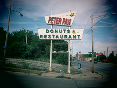 Eternal Youth. (david grim) Tags: eastcleveland oh ohio cuyahogacounty streetphotography peterpandonuts sign