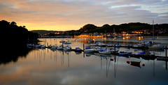 River Conwy Sunset (Peter.S.Roberts) Tags: interestingness interesting conwy northwales river boats sundown masts sun water calm placid lights reflections longexposure depthoffield tranquil peaceful composed still restful untroubled buildings mountains trees houses summer clouds seascape riverscape landscape settingsun riverconwy arfonconwy nightfall boating yachts yachting powerboats moorings jetty explore fluidr flickriver