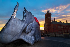 Seafarers' Memorial (A J Thackway) Tags: cardiffbay cardiff caerdydd memorial remember lastlight dusk sun sunset summer colours saturation bright sea seafarers lost dead canon 6d tripod yongnuo yn568exii wireless trigger face southwales wales cymru sky light lit flash ef24105mmf4l lglass hoya polariser wideopen wideangle 24mm filter landscape cityscape city life