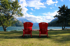 Waterton Lakes National Park (ashleyk.wiebe) Tags: watertonlakesnationalpark alberta mountains sky clouds blue water red chair adirondack