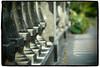 Railing repetition (Eric Flexyourhead) Tags: bridge canada vancouver fence bc bokeh britishcolumbia pinhole railing vignette 45mm coalharbour reptition zd artfilter devonianharbourpark mzuikodigital45mmf18 olympusem5