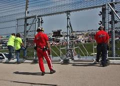 Open (spincast1123) Tags: shadow red summer people men yellow racetrack race truck canon fence illinois wire workers gates pavement caps microphones hats september safety equipment event nascar barrier geico posts earmuffs protection joliet 2012 blacktop employees copywrite protected chicagolandspeedway hearingprotection 40d canon40d spincast1123 geico400 chaseforthechampinoship