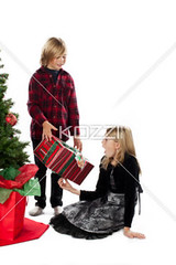 image of a brother giving a christmas present to his sister (peeps2012ilay) Tags: christmas xmas winter boy vacation portrait holiday cute male girl childhood festival female festive season happy photography holding december sister brother joy innocent adorable teenagers happiness siblings christmastree celebration indoors event whitebackground gifts gift giving presents portraiture blonde surprise innocence sharing present surprised studioshot blondehair occasion twopeople casualwear caucasian christmasgift toothysmile puerile casualclothing teenagegirl relation teenageboy colorimage christmasspirit lookingatcamera passingon 1213years puerility 1314years humanrelation publiccelebratoryevent
