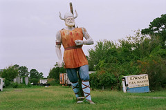 The Viking of Chincoteague (damiec) Tags: film statue v va americana viking roadsideattractions film26 chincoteague nikkormat weirdva heishugetractortrailersprovidealittlescale