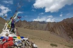 Prayer flags in the Stok river valley (Miche & Jon Rousell) Tags: blue red sky cloud india mountain yellow trekking river prayer buddhism summit prayerflags himalaya ladakh stokkangri stokriver