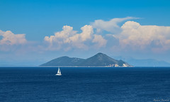 Lone sailboat (wolfpackWX) Tags: ocean travel blue sea summer sky nature water weather clouds landscape landscapes boat mediterranean greece sail