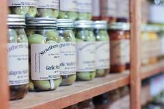 Mason jars on display (Adam J. Gramling) Tags: approved south carolina hilton head island vacation southern america mason jar jam jelly fruit canned goods garlic