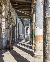 Leading lines (Jodi Newell) Tags: canon cuba havana jodinewell jodisjourneys jodisjourneysphotosgmailcom lahabana people poles shadows street vanishingpoint