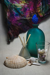 Still life with a green bottle (Alexander Pugatschewski) Tags: stilllife green bottle sinks background fabric texture structure shell snail scallop shadow light bunch grape coarse glass mat shank scarf color fringe