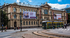 2016 - Baltic Cruise - Helsinki - Ateneum Museum (Ted's photos - For Me & You) Tags: 2016 cropped tedmcgrath tedsphotos vignetting helsinki helsinkifinland finland ateneum ateneumhelsinki finnishnationalgallery finnishnationalgalleryhelsinki rautatientorisquare theodorhijer pram bicycle street streetscene trolley tracks crosswalk building oldbuilding bicycles streetcar people peopleandpaths