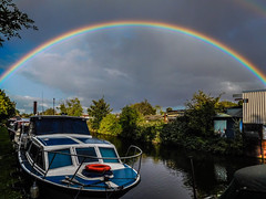 under the rainbow bridge (watergypsyrach) Tags: rainbow rainclouds boat canal southyorkshirenavigation rotherham england uk weather nikoncoolpixs7000 landscape