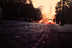 scurry (ewitsoe) Tags: street morning light 35mm 50mm nikon pov low poland cobblestones trams bimba poznan d80
