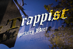 the trappist (thermophle) Tags: california sunlight reflection beer sign oakland trappist