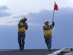 Sailors wave a guide flag. (Official U.S. Navy Imagery) Tags: heritage america liberty freedom commerce unitedstates military navy sailors fast worldwide tradition usnavy protect deployed flexible philippinesea onwatch beready defendfreedom warfighters nmcs chinfo sealanes warfighting preservepeace deteraggression operateforward warfightingfirst navymediacontentservice cvn73georgewashingtonhsc25islandknightsameliaearharttake6quartermasters