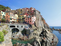Picturesque Manarola tripping down the ravine and swimming hole (Bn) Tags: world ocean park pink flowers blue trees houses sea vacation sky orange sunlight flower tower heritage water colors beautiful weather saint train swimming buildings coast boat topf50 warm mediterranean italia sailing ship torre gulf hole hiking path five character liguria shoreline hike case cliffs quay historic bougainvillea unesco via vineyards national terre sail ravine mountainside overlooking quaint inspire incredible viewpoint picturesque coloured topf100 manarola cinque giovanni italians italianriviera torri confraternita battista dellamore 100faves 50faves guardiolas