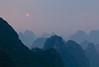 Yangshuo sunset (The Ends of Invention) Tags: china travel sunset sun mountains nature canon landscape photo asia yangshuo lphills