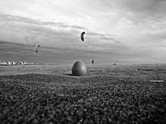 wind... ((rino)) Tags: sea people blackandwhite bw storm beach clouds photo sand flickr wind egg kites rino