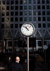 Canary Wharf Time (Che-burashka) Tags: london clock businessman architecture time wharf canary juxtaposition bold businessdistrict businessandfinance