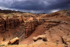 kazakhstan (mariusz kluzniak) Tags: red storm rain clouds lens landscape rocks asia view desert angle sony central wide sigma dry super canyon semi alpha 1020mm kazakhstan 77 slt lenses a77 charyn
