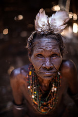 old woman dassanech(galeb) tribe (anthony pappone photography) Tags: africa travel portrait people woman digital canon pose photography photo eyes foto faces image expression retrato african picture culture hut portraiture afrika omovalley fotografia ethiopia tribe ritratto blackgirl necklaces reportage photograher collane afrique faccia omo eastafrica phototravel etiopia etnic  etnico capanna ethiopie turkana etiope etnia  galeb loweromovalley etnica etnologia afryka omorate etiopija  dassanech etiopien etipia africantribe  etiopi dassanechtribe eos5dmarkii dasanach  lowervalleyoftheomo lowervalleyomo
