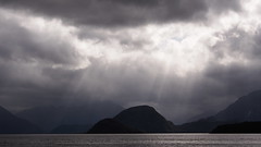 Stormy Sky (blue polaris) Tags: park new travel light summer cloud sun lake storm clouds landscape island spring scenery track hiking walk south great conservation olympus hike zealand national nz rays te anau doc tramping department kepler manapouri tramp sunray omd fiordland em5