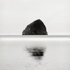Haystack Rock, Oregon Coast (austin granger) Tags: longexposure reflection film oregon composition coast time symmetry flux mind impermanence change geology haystackrock largeformat seastack pacificcity deardorff austingranger