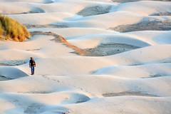 Walk on the beach in Newport (Lostinplace) Tags: newportoregon beach dunes sand beachsand nyebeach blue tan sunset walking footprints trail hat hiking hiker oregoncoast oregon oceandunes green yellow seagrass pattern