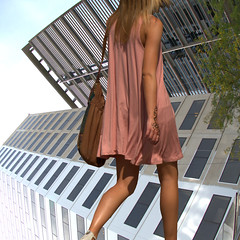 Changing Directions (swong95765) Tags: sideways buildings city woman walking perspective twisted life tattoo